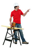 Carpenter pointing to empty copyspace — Stock Photo
