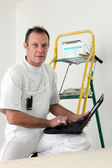 Painter equipped with computer — Stock Photo