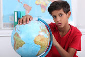 Pupil with globe — Stock Photo