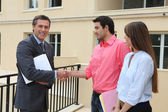 Couple shaking the hand of a real estate agent — Stock Photo