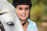 Blond female horse rider — Stock Photo