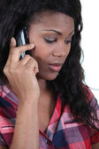 A black woman at phone — Stock Photo