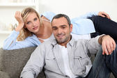 Happy couple resting at home — Stock Photo