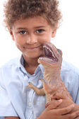Little boy playing with toy dinosaur — Stock Photo