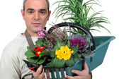 A florist with his creation — Stock Photo