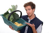 Man with basket of vegetables — Stock Photo