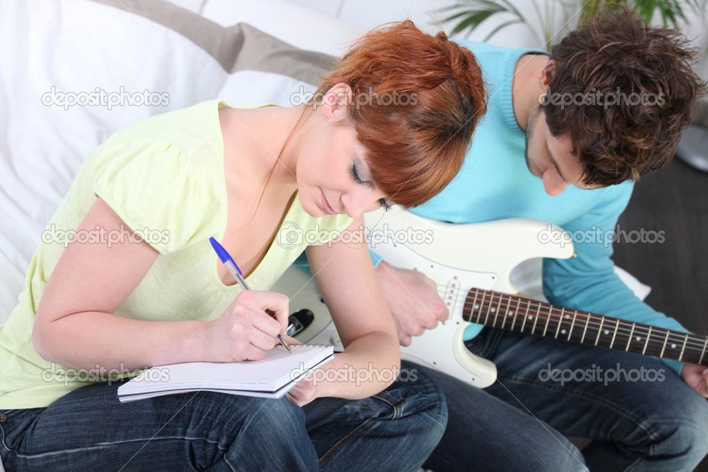 Youth writing song  Stock Photo #10847349