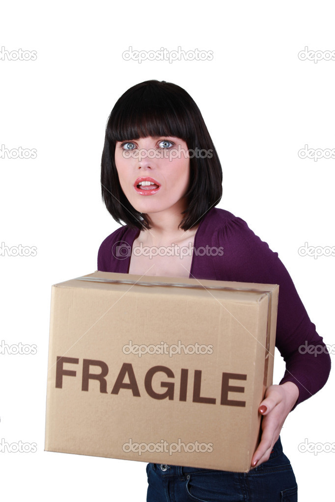 Woman carefully holding fragile box — Stock Photo #10847651