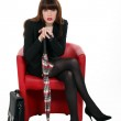 Elegant business woman sitting in armchair — Stock Photo