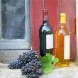 Two bottles of wine on rustic windowsill — Stock Photo