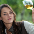 Woman looking glass of wine — Stock Photo