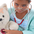 Little girl dressed in nurses outfit — Stock Photo