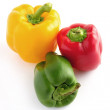图库照片: Red, green and yellow peppers