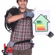Stock Photo: Craftsmholding energy consumption label