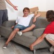 Stock Photo: Three young men moving room