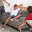 Foto Stock: Three young men moving room
