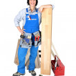Female carpenter with tools - Stock Photo
