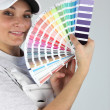 Foto Stock: Female decorator with paint swatch