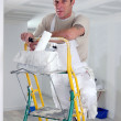 Painter climbing ladder — Stock Photo