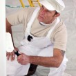 Decorator painting a room white — Stock Photo