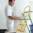 Stockfoto: Decorator choosing color from swatch