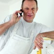 Painter making a call — Stock Photo