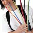 Woman holding pipe cleaners — Stock Photo