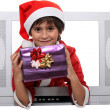 Royalty-Free Stock Photo: Little boy dressed as Santa escaping from television set