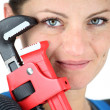 Stock Photo: Womholding adjustable wrench
