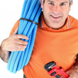 Stock Photo: Plumber with wrench and plastic pipe