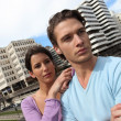 Couple in front of tall buildings area — Stock Photo
