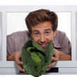 Man presenting cabbage — Stock Photo #10856415