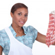 Stock Photo: Female butcher with rack of ribs
