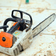 Chain-saw on construction site - Stock Photo