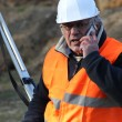 Senior surveyor on construction site — Stock Photo