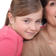 Mother and daughter close together — Stock Photo