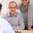 Stock Photo: Retired couple playing chess