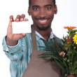 Royalty-Free Stock Photo: Male florist with business card