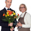 Foto Stock: Portrait of a florist and a man wearing a tuxedo