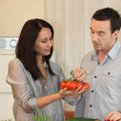 Stock Photo: Couple debating which vegetables to cook
