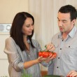 Royalty-Free Stock Photo: Couple debating which vegetables to cook