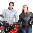 Stock Photo: A man, a woman and a motorbike.