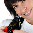 Woman cutting wire with special tool - Stock Photo