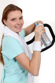 Woman hydrating herself after workout — Stock Photo