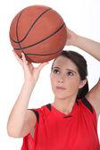 Girl throwing basketball — Stock Photo