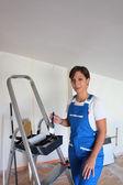 Female decorator with stepladder — Stock Photo