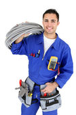 Electrician stood with cabling — Stock Photo