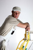 Decorator up ladder — Stock Photo