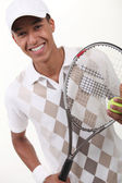 Portrait of a teenager with racket — Stock Photo
