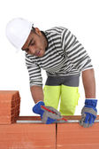 A bricklayer using a ruler — Stock Photo